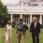 11. Laura with President Clinton and Eagle handler prior to a South Lawn event which celebrated taking the Eagle off of the endangered species list