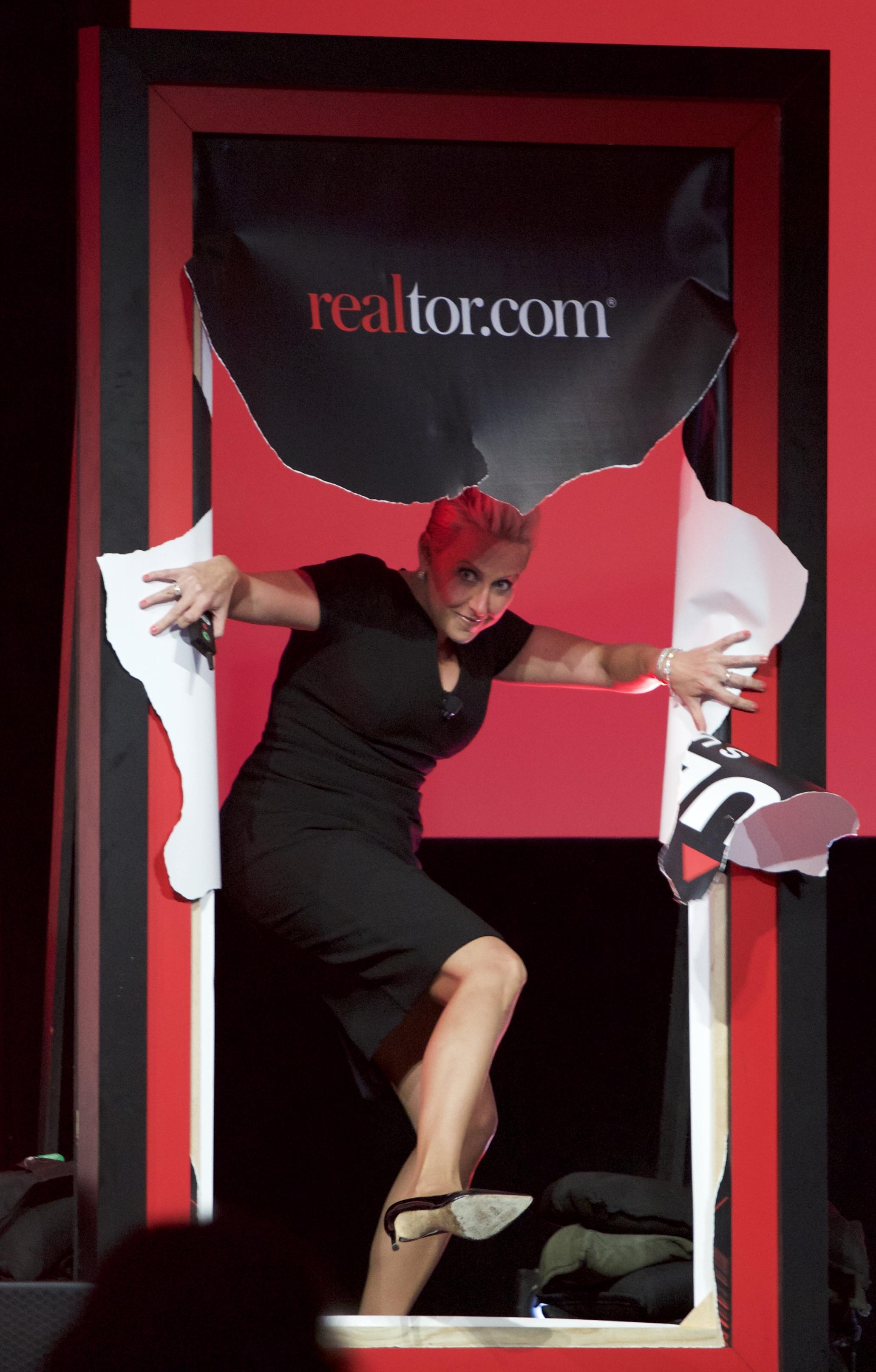 Laura Schwartz breaks through wall at Realtor.com Results Summit.